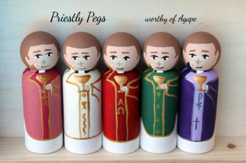Priestly pegs full set Eucharist on face