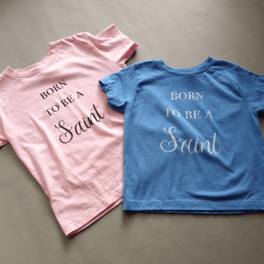 born to be a saint pink and blue flatlay