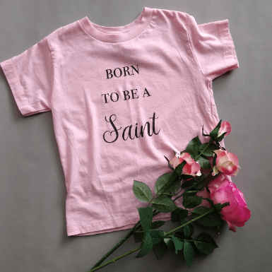 born to be a saint pink flatlay roses